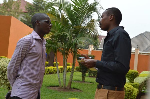 Jean Bigirimana discussing with a colleague.