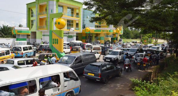 Many cars queuing up for fuel on one gas station in the south of the Burundian capital