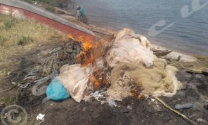 Some instruments which are not allowed to be used in fishing were burnt by the technical commission in charge of securing lake navigation