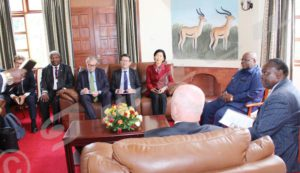 Facilitator Mkapa in a meeting with the special envoys.
