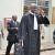 Frédéric Bamvunginyumvira en costume et cravate à la sortie de l'audience avec ses avocats ©Iwacu