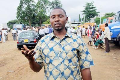 Christian Mugisha au parking du Cotebu ©Iwacu