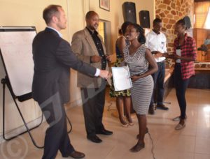 Participants in the boot camp receiving their certificates