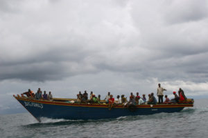 Passengers from Rumonge to Congo travel by small overloaded boats with no life jackets