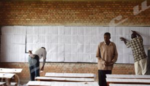 People searching for their names on the provisional lists at Lycée communal Musaga